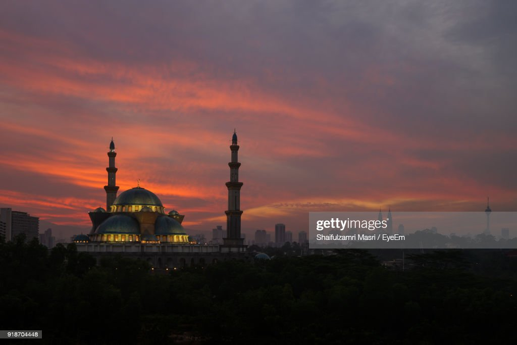 Mosque Against Cloudy Sky During Sunset : Stock Photo