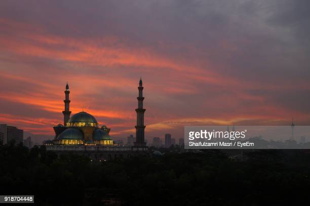 mosque against cloudy sky during sunset - shaifulzamri stock pictures, royalty-free photos & images