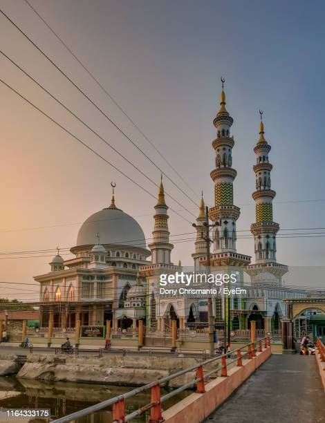 mosque against sky during sunset - surabaya stock pictures, royalty-free photos & images