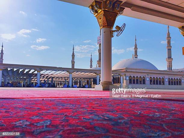 mosque against sky - al madinah stock photos and pictures