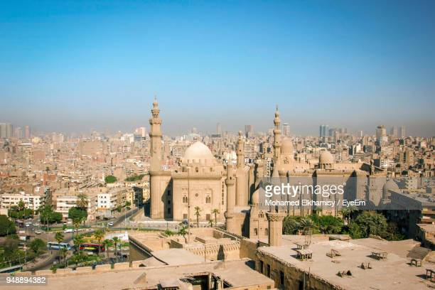 mosque amidst city against sky - cairo stock pictures, royalty-free photos & images