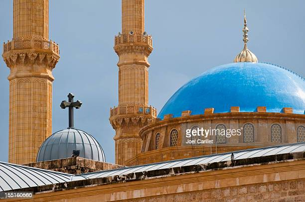 mosque and church juxtaposed in beirut, lebanon - mosque stock pictures, royalty-free photos & images