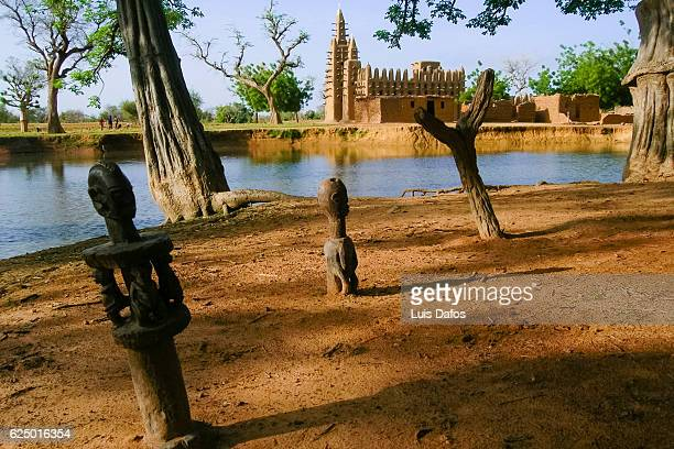 mosque and tribal statues