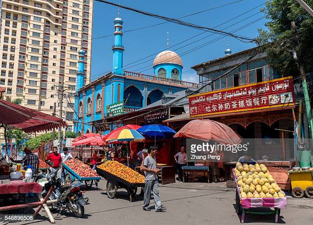 Mosque and Uygur restaurants on the center of Hanren Jie Han People street in Yining the previous dwelling center of Han in the city is now one of...