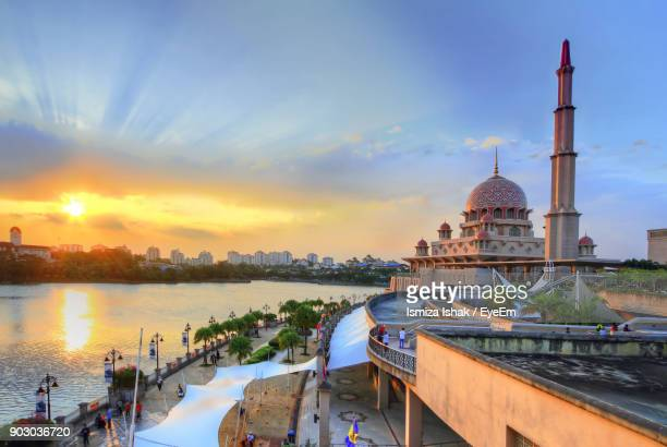 Mosque By River At Sunset