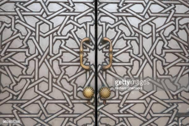 mosque doors - hassan ii mosque, casablanca - casablanca morocco stock pictures, royalty-free photos & images