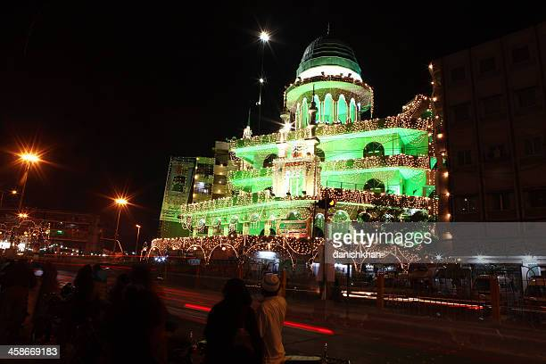 mosque illuminated on last prophet mohammad (pbuh) birth celebra - muhammad prophet stock photos and pictures