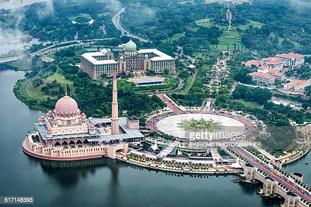 mosque in putrajaya - putrajaya stock photos and pictures