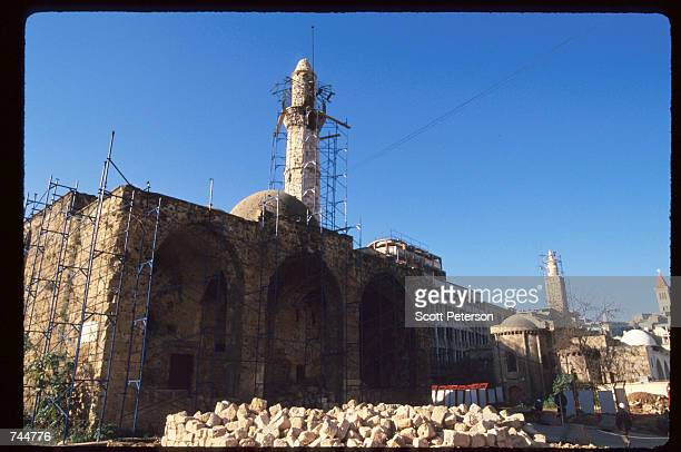 A mosque is covered with scaffolding January 13 1997 in Beirut Lebanon The Bourse de Beyrouth was closed in 1983 during Israel's invasion and...