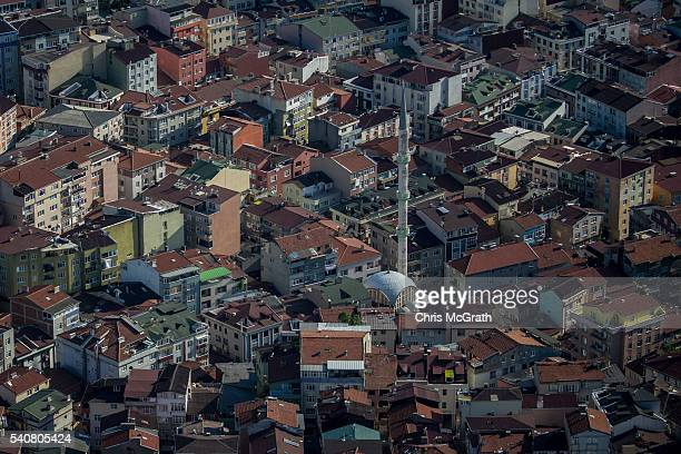 A mosque is seen amid residential housing in an Istanbul neighbourhood on June 16 2016 in Istanbul Turkey