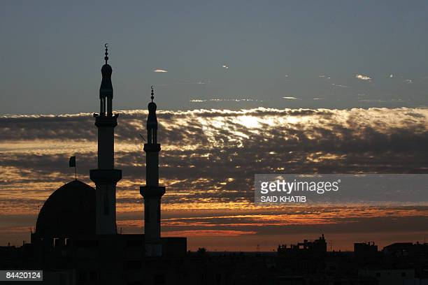 A mosque is silhouetted at sunset in the southern Gaza Strip town of Rafah on the border with Egypt on January 03 2009 An Egyptian border guard was...