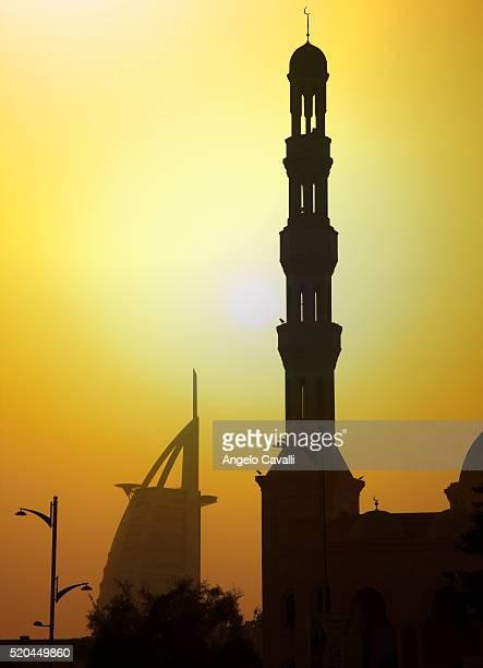 mosque minaret and burj al arab hotel - minaret stock pictures, royalty-free photos & images