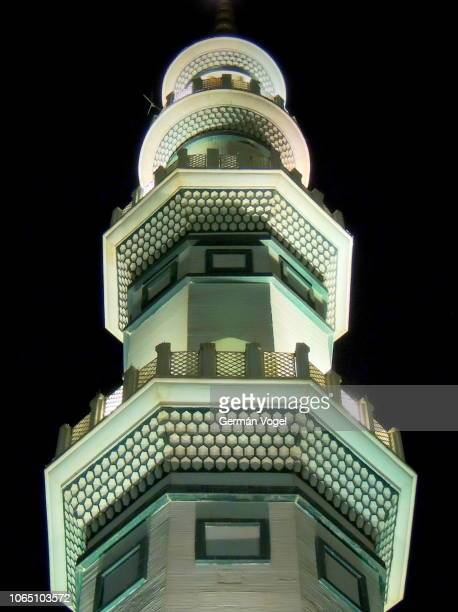 mosque minaret at night in the jamkaran mosque of qom associated to imam mahdi, the savior or messiah of muslims, iran - jamkaran mosque stock pictures, royalty-free photos & images