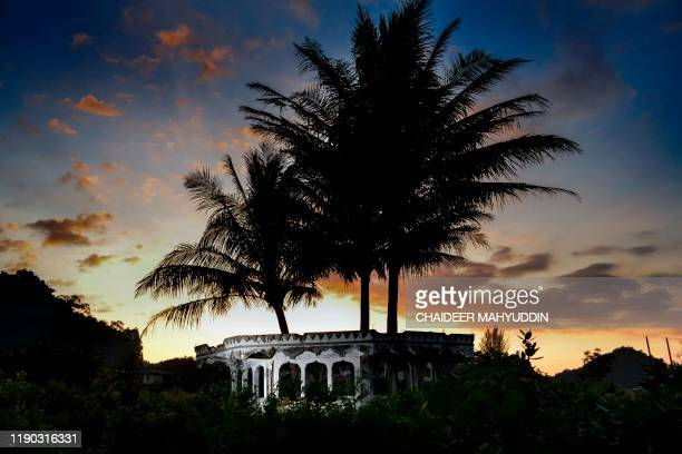 A mosque minaret devastated on 2004 by an earthquake and tsunami called 'Boxing Day Tsunami' is pictured in Lhokseudu Aceh province on December 24...