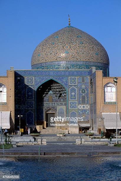 Mosque of the Sheiykh Lutf Allah 16011618 17th Century mixed technique Iran Isfahan Whole artwork view In front of a fountain stand the portal and...