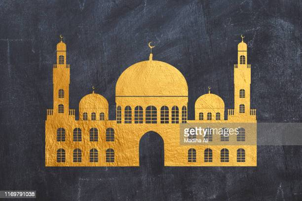 a mosque or masjid illustration in gold or golden foil over black - eid ul fitr illustrations stock pictures, royalty-free photos & images