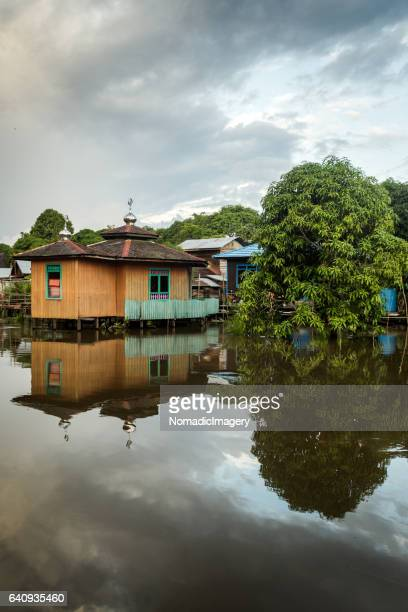 Mosque reflected in Borneo river water