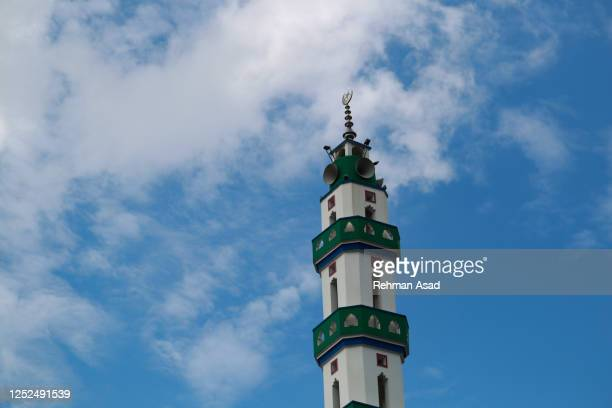 mosque tower against sky - dhaka stock pictures, royalty-free photos & images