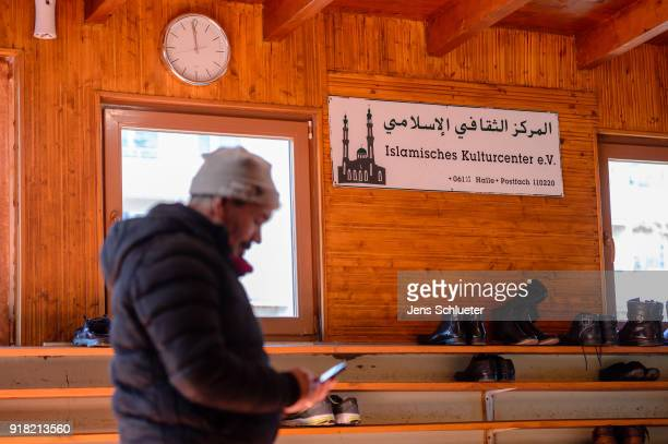 A mosque visitor stands in the Muslim cultural center and mosque as Aydan Ozoguz German Federal Commissioner for Immigration Refugees and Integration...