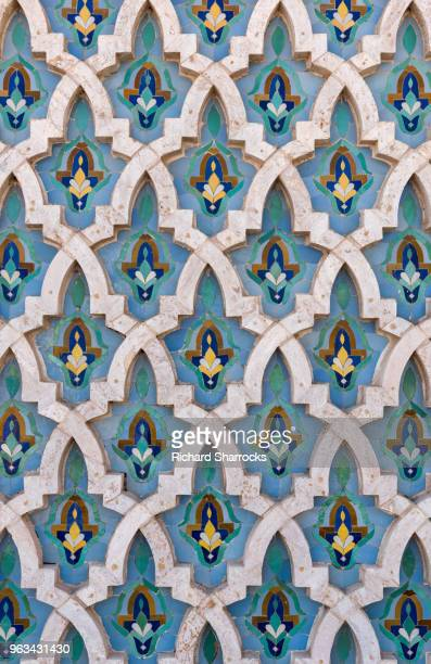 mosque wall tiles - hassan ii mosque, casablanca, morocco - african pattern stock photos and pictures