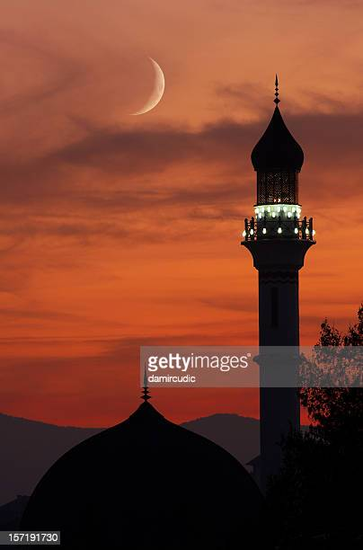 mosque with crescent moon at dusk - mosque stock pictures, royalty-free photos & images