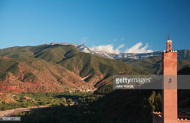mosque with snow on high atles mountains, ourika valley, morocco - jake warga stock pictures, royalty-free photos & images