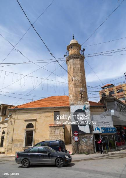 Mosque with the giant portrait of abbas almusawi an hezbollah martyred leader Beqaa Governorate Baalbek Lebanon on May 1 2017 in Baalbek Lebanon