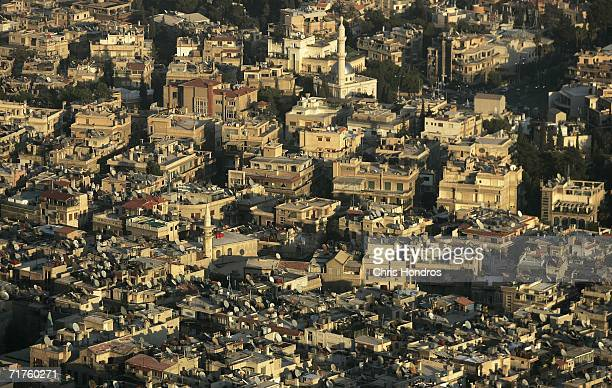 Mosques and lowrise buildings cover the cityscape as viewed from Mount Qaysun August 31 2006 overlooking Damascus Syria Life in Damascus under...