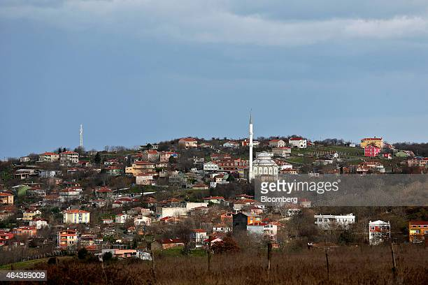 Mosques and residential houses stand on the village skyline in an area planned for the development of Istanbul's third airport in Tayakadin Turkey on...