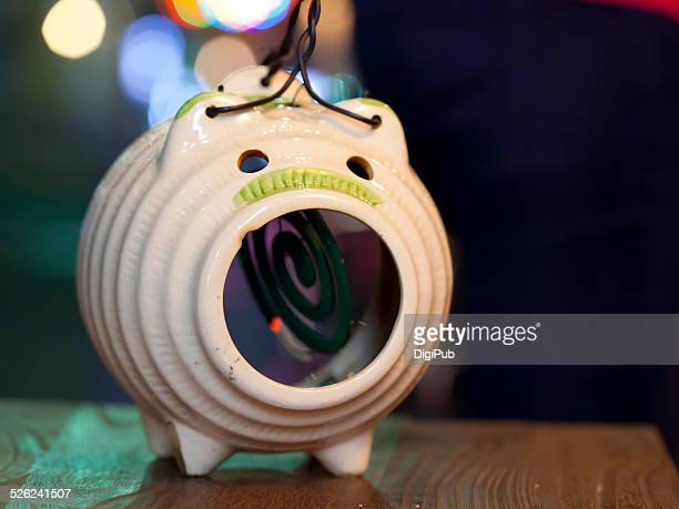 Mosquito coil pot in use