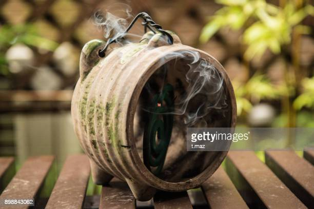 mosquito coils are pig-type pottery to be in. - incense coils stock photos and pictures