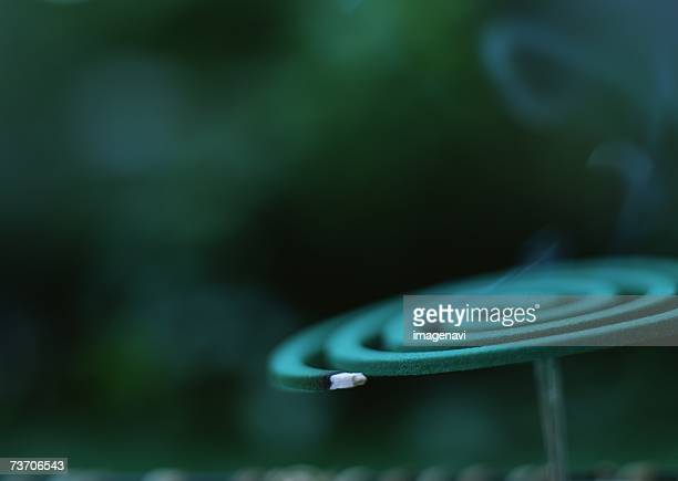 mosquito coils - incense coils stock photos and pictures