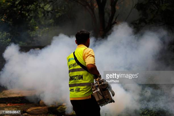 A mosquito expert of the Korea disinfection crupee team sprays garden pesticide to kill mosquitoes to concerns over the outbreak of dengue in...