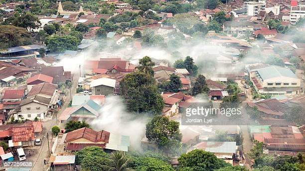 mosquito fogging aerial view - dengue fotografías e imágenes de stock
