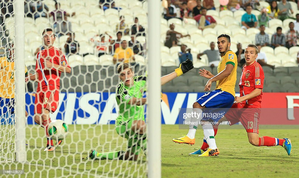 Mosquito of Brazil scores the opening goal during the FIFA U-17 World Cup UAE 2013 Round of 16 match between Brazil and Russia at the Mohamed Bin Zayed Stadium on October 28, 2013 in Abu Dhabi, United Arab Emirates.