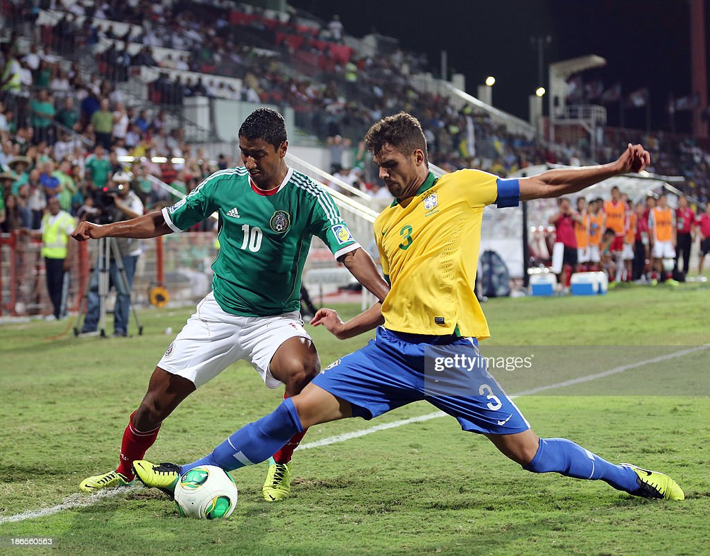 Mosquito (R) of the Brazil vies for the ball against Luis Hernandez (L) of Mexico during their FIFA U-17 World Cup UAE 2013 football match in Dubai, on November 1, 2013. Mexico won 11-10 in a penalty shootout.