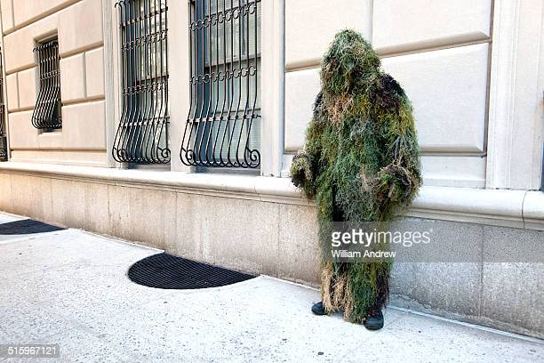 moss man monster standing on street - very scary monsters stock photos and pictures