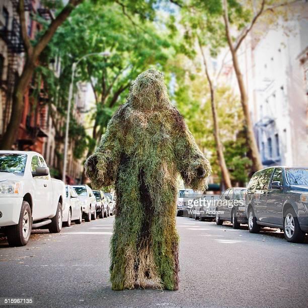 moss monster in urban landscape - scary monster ストックフォトと画像