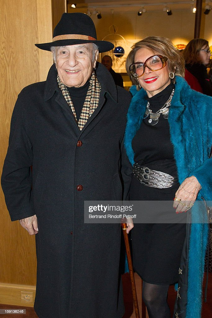 Mossem Banihashem (L) and his wife Azar attend the 'Sorcieres' (Witches) exhibition preview at Galerie Pierre Passebon on January 8, 2013 in Paris, France.