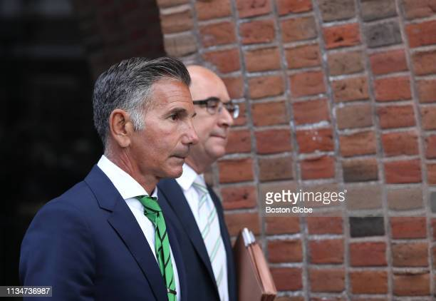 Mossimo Giannulli left husband of actress Lori Loughlin follows her out of the John Joseph Moakley United States Courthouse in Boston on April 3 2019...