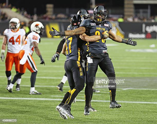 Mossis Madu of the Hamilton Tigercats prematurely celebrates a score against the BC Lions in a CFL football game at Tim Hortons Field on October 4...