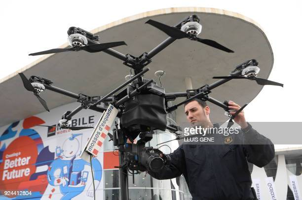 A 'Mosso D'Esquadra' checks a police security drone at the Mobile World Congress the world's biggest mobile fair on February 26 2018 in Barcelona The...