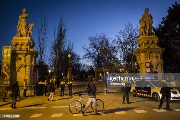 Mossos d'Esquadra police officers stand guard at the gates to Parc of Cuitadella near the Catalan parliament in Barcelona Spain on Wednesday Jan 17...