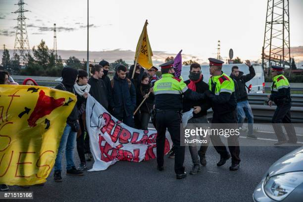 Mossos d'Esquadra police trying to open the path trought the students of the Universitat Autonoma de Barcelona during the general strike of 8N at...