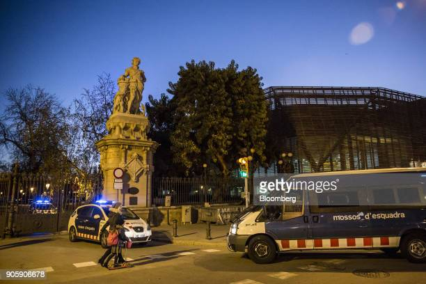 Mossos d'Esquadra police vehicles stand at the gates to Parc of Cuitadella near the Catalan parliament in Barcelona Spain on Wednesday Jan 17 2018...