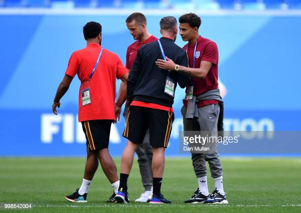 Mossua Dembele and Toby Alderweireld of Belgium speak to Tottenham Hotspur teammates Eric Dier and Dele Alli of England during a pitch inspection...