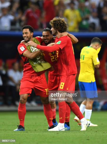 Mossua Dembele Nacer Chadli and Marouane Fellaini of Belgium celebrate following their sides victory in the 2018 FIFA World Cup Russia Quarter Final...