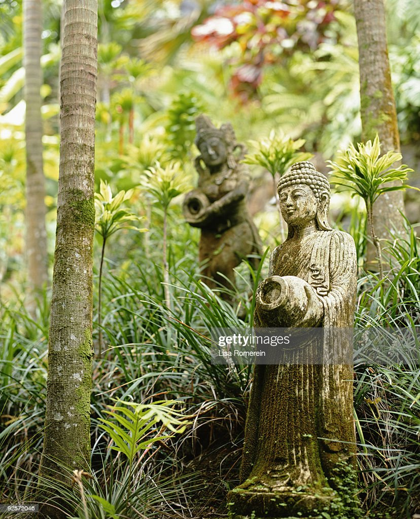 Mossy Statues In Lush Tropical Garden : Stock Photo