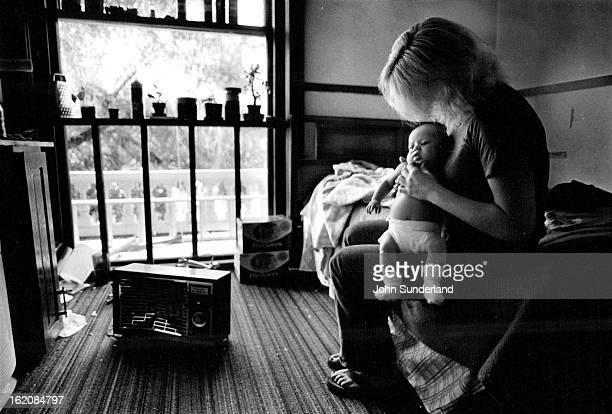 INFANT Most families in hotels or confined one room children ploy in olley where one was recently attached