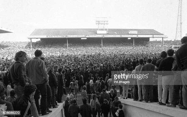 Most of fortysix thousand crowd at Maine Road ground Manchester invade the pitch after Manchester City had won 51 in their Canon League Division Two...